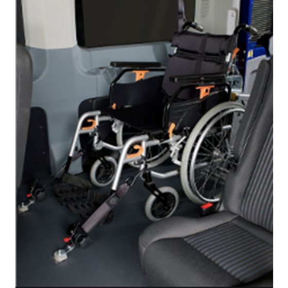 Moving and securing wheelchairs in a vehicle Image